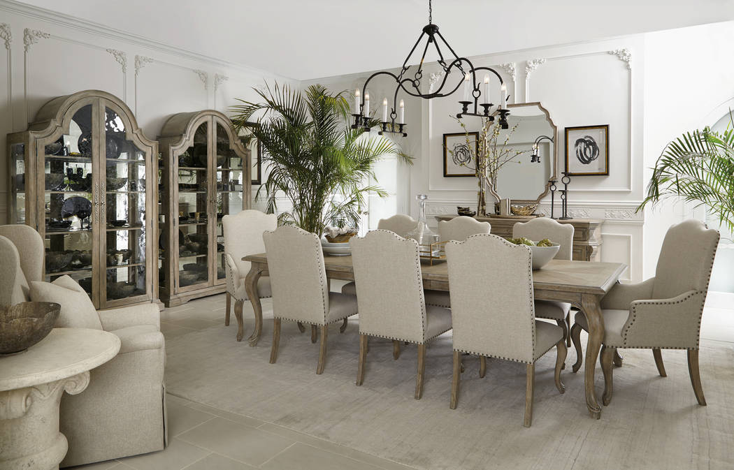 AFTER: The modern kitchen is replacing the Tuscan-style with lighter colors and clean, straight lines. (Luxury Designer)