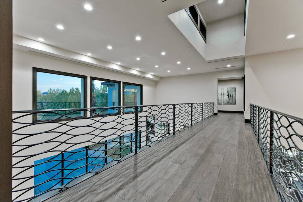 Lofts with modern ironwork are popular for contemporary designs. (Luxury Designer)