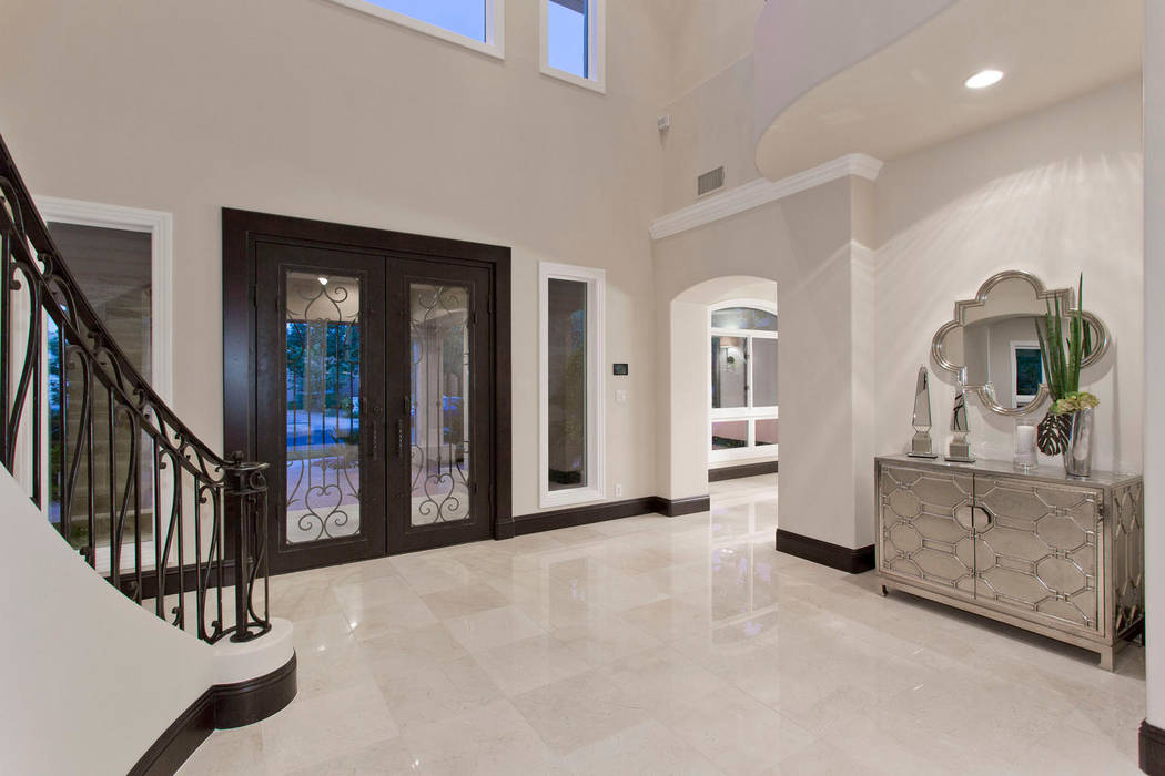 Real estate experts say homeowners are remodeling luxury homes to reflect current preferences for modern design. (Luxury Designer)