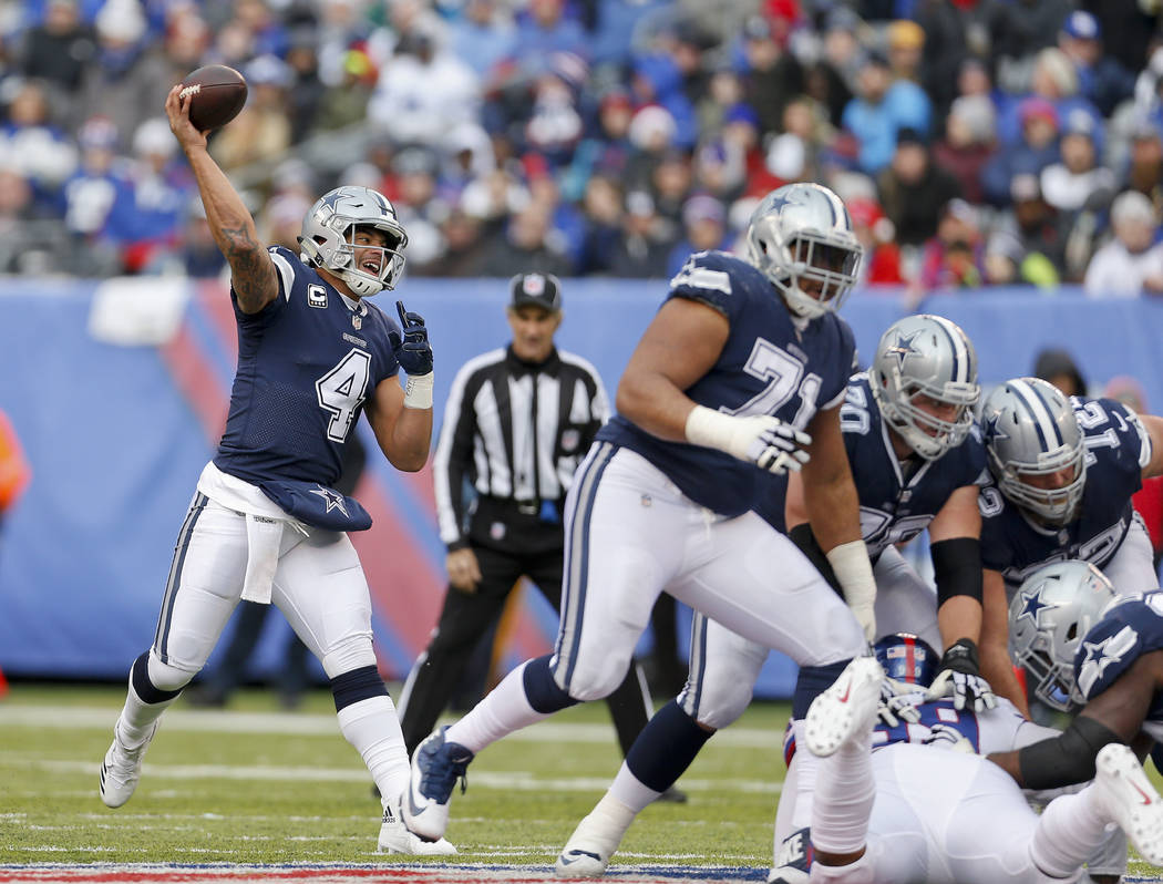 Dallas Cowboys quarterback Dak Prescott (4) passes against the New York Giants during the fourth quarter of an NFL football game, Sunday, Dec. 10, 2017, in East Rutherford, N.J. (AP Photo/Adam Hunger)