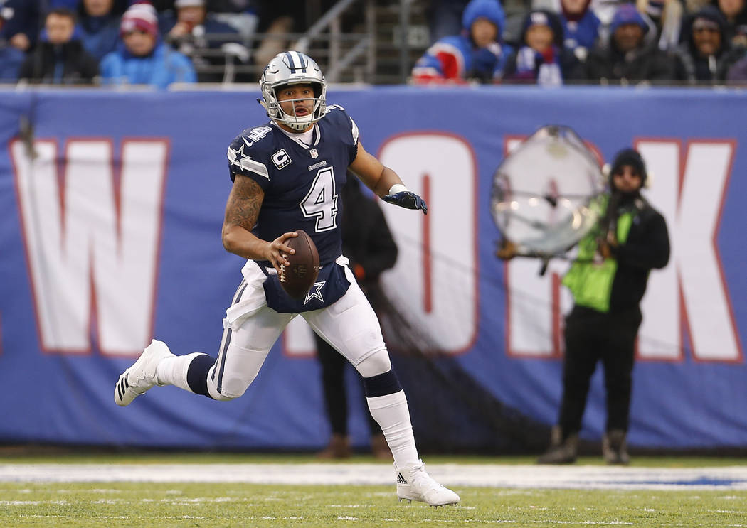 Dallas Cowboys quarterback Dak Prescott (4) looks to pass against the New York Giants during the fourth quarter of an NFL football game, Sunday, Dec. 10, 2017, in East Rutherford, N.J. (AP Photo/A ...