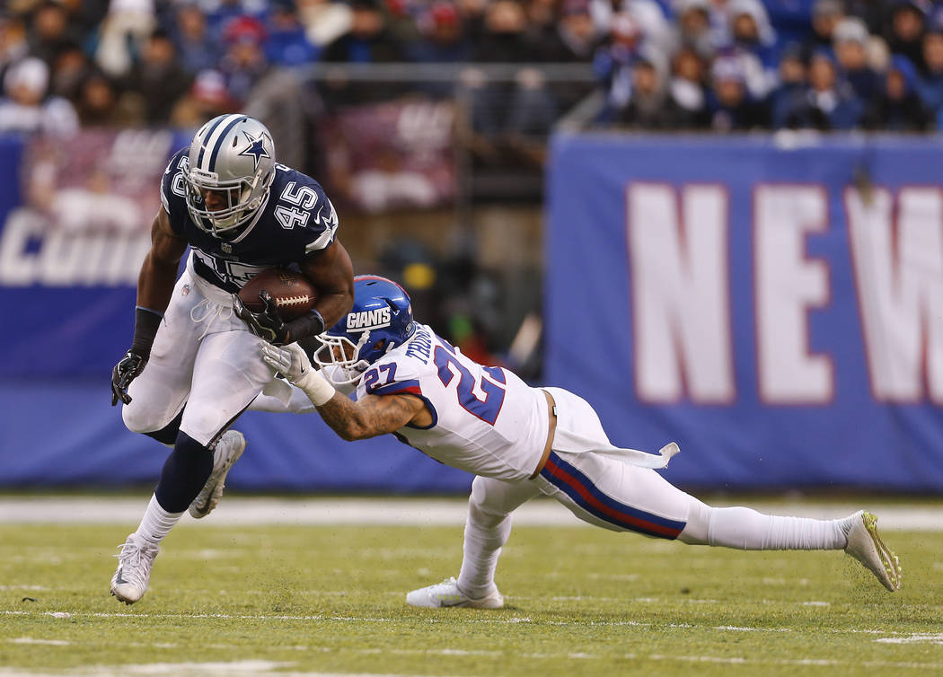 Dallas Cowboys running back Rod Smith (45) runs the ball against New York Giants free safety Darian Thompson (27) during the fourth quarter of an NFL football game, Sunday, Dec. 10, 2017, in East  ...