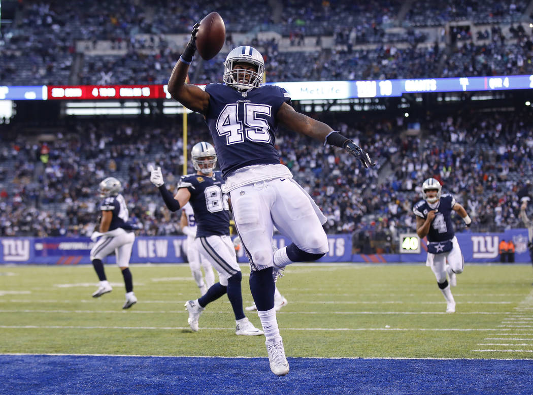 Dallas Cowboys running back Rod Smith (45) reacts after scoring a touchdown against the New York Giants during the fourth quarter of an NFL football game, Sunday, Dec. 10, 2017, in East Rutherford ...