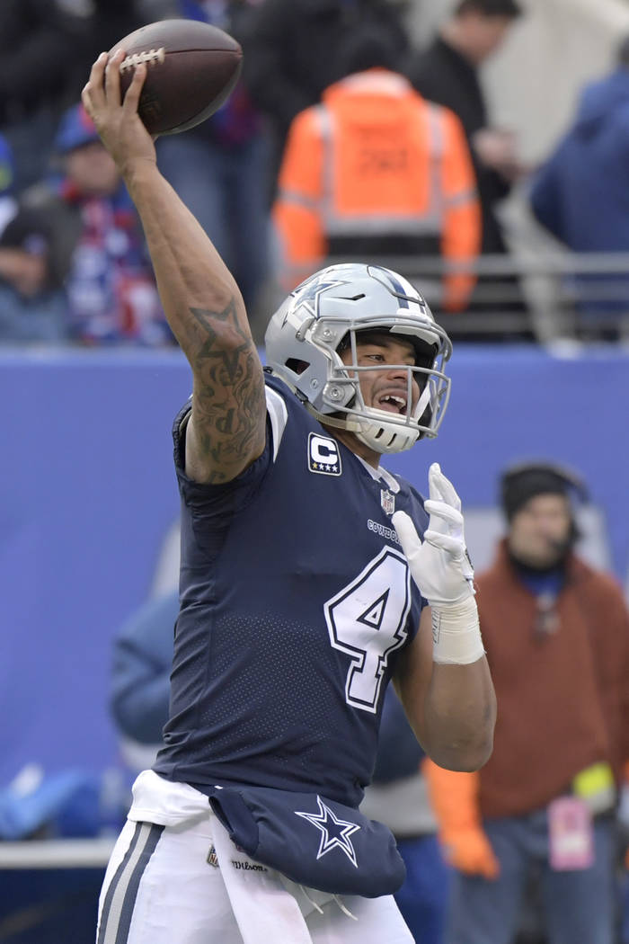 Dallas Cowboys quarterback Dak Prescott (4) throws a pass during the second half of an NFL football game against the New York Giants, Sunday, Dec. 10, 2017, in East Rutherford, N.J. (AP Photo/Bill ...
