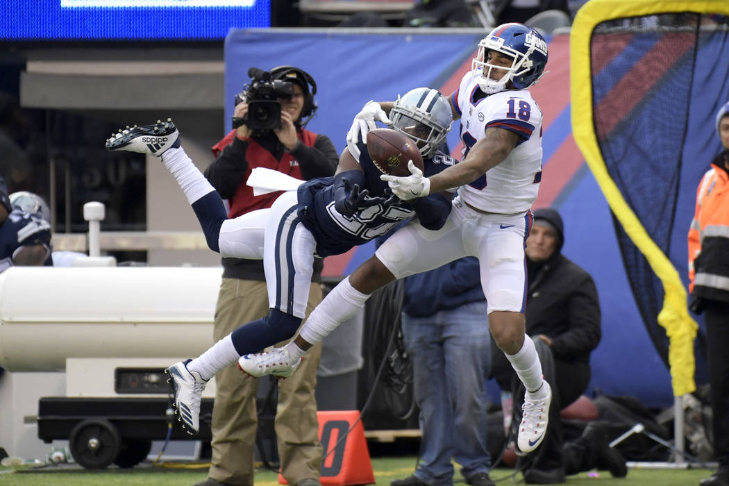 Dallas Cowboys cornerback Jourdan Lewis (27) breaks up a pass intended for New York Giants wide receiver Roger Lewis (18) during the third quarter of an NFL football game, Sunday, Dec. 10, 2017, i ...