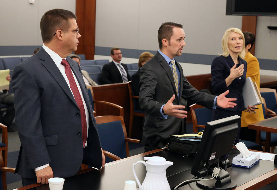 Attorney Samuel Warren, center, representing Travis Phippen, whose father died in his arms during the Oct. 1 shooting, speaks as Alice Denton, right, and Timothy Titolo, representing the shooting  ...