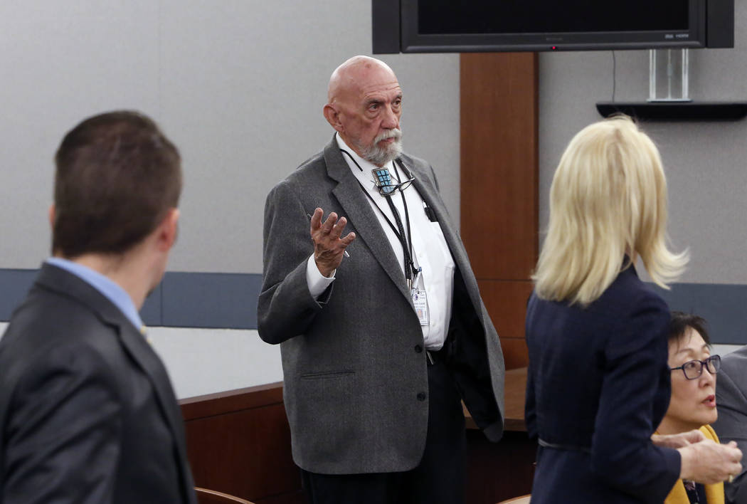 Clark County Public Administrator John Cahill, center, speaks as attorney Alice Denton, representing the Oct. 1 shooting victims, right, and Samuel Warren, representing Travis Phippen, whose fathe ...