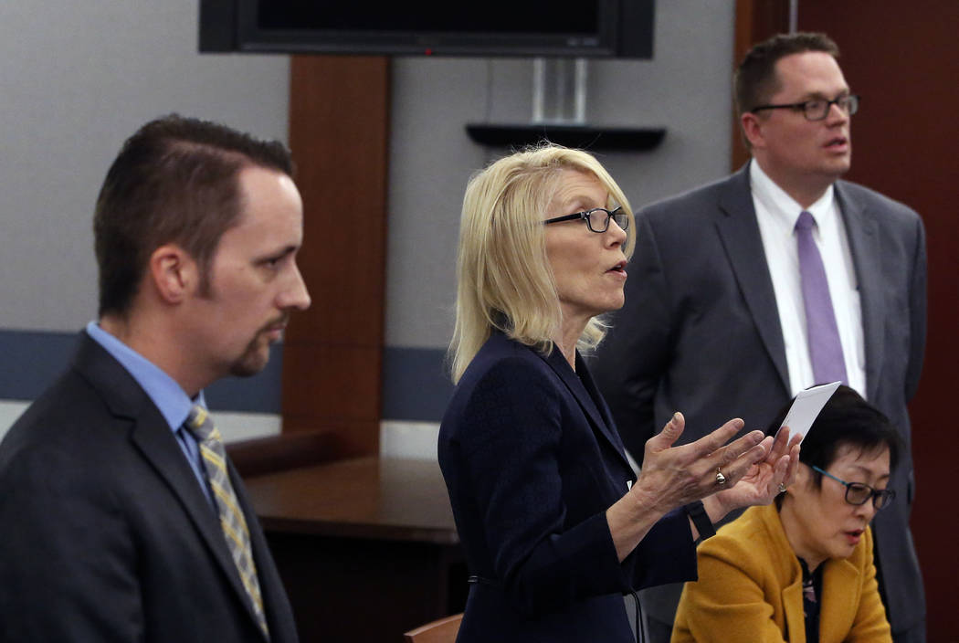 Attorneys Alice Denton, center, Thomas Grover, right, and Samuel Warren appear on Thursday, Dec. 14, 2017, at the Regional Justice Center during a hearing in the probate matter for the estate of g ...