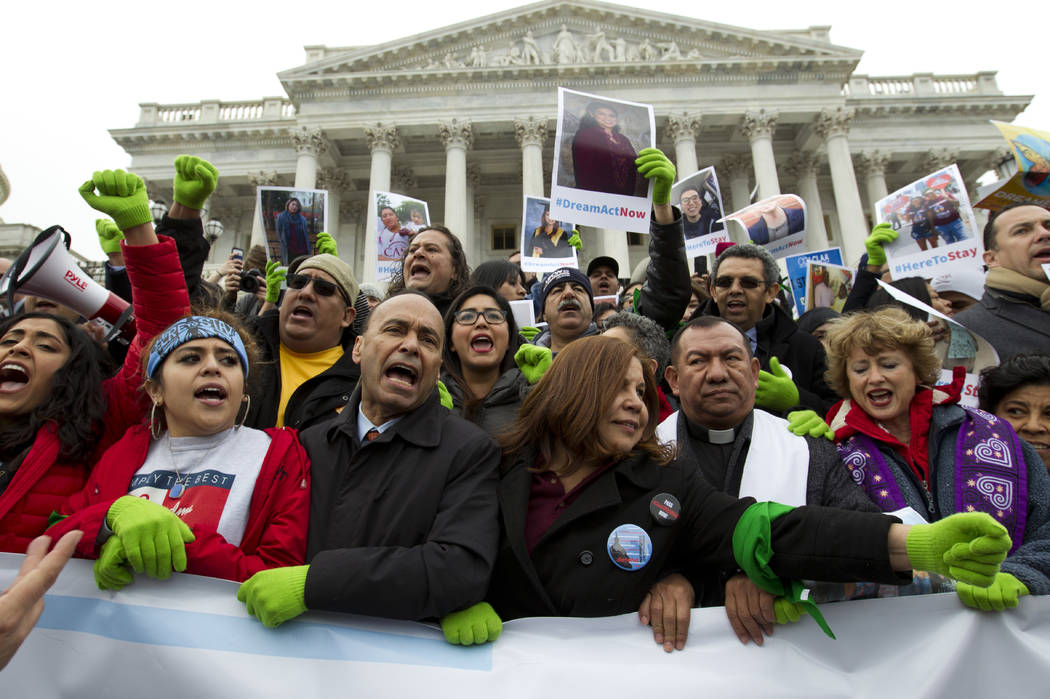 In this De. 6, 2017 photo, Rep. Luis Gutierrez D-Ill., third from left, along with other demonstrators protest outside of the U.S. Capitol in support of the Deferred Action for Childhood Arrivals  ...