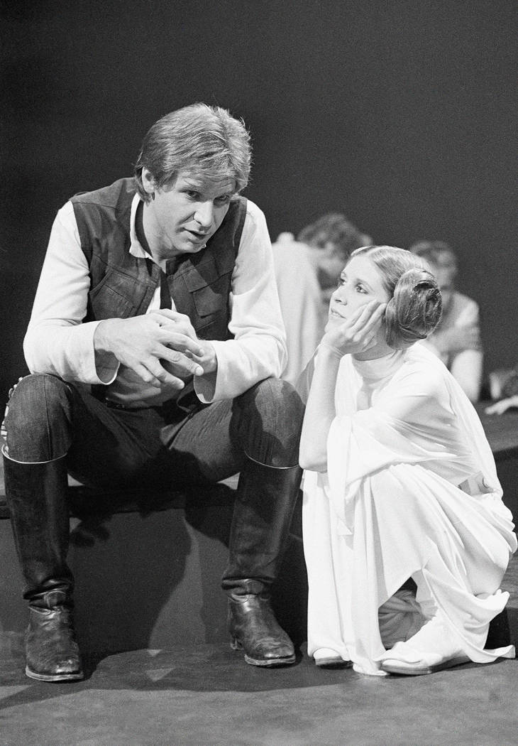 "Harrison Ford, as Han Solo of ""Star Wars"" fame chats with Carrie Fisher Nov. 13, 1978 during a break in the filming of the CBS-TV special ""The Star Wars Holiday."" Ford  ..."