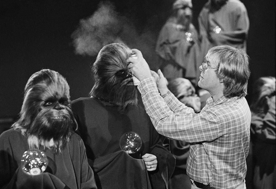 "An ""extra"" Wookie has his hair sprayed by a makeup artist during the taping of the television special for the holidays made by the cast of the movie ""Star Wars"" ..."