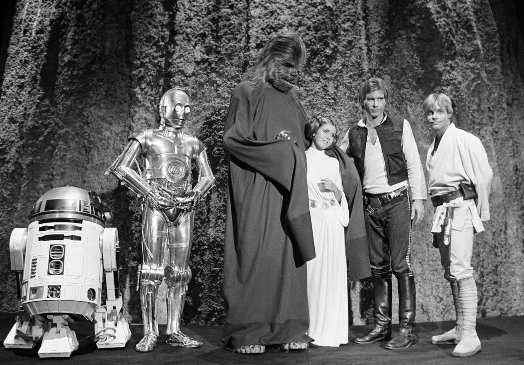 "In this Nov. 13, 1978 file photo, shows, from left, Kenny Baker, Anthony Daniels, Peter Mayhew, Carrie Fisher, Harrison Ford, and Mark Hamill during the filming of the CBS-TV special ""The Star War ..."