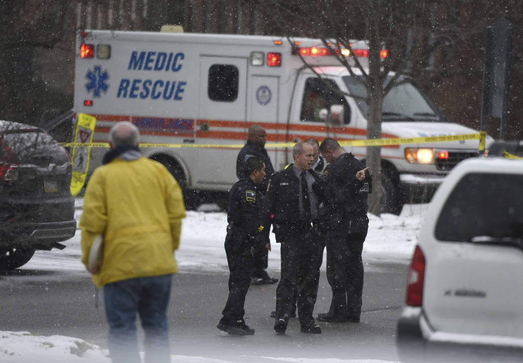 Authorities investigate the scene of a shooting at the Penn State University campus in Beaver County in Monaca Pa. Wednesday Dec. 13 2017