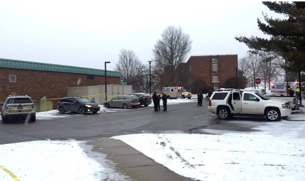Authorities investigate the scene of a shooting at the Penn State University campus in Beaver County in Monaca, Pa., Wednesday, Dec. 13, 2017. (Kate Malongowski/Beaver County Times via AP)