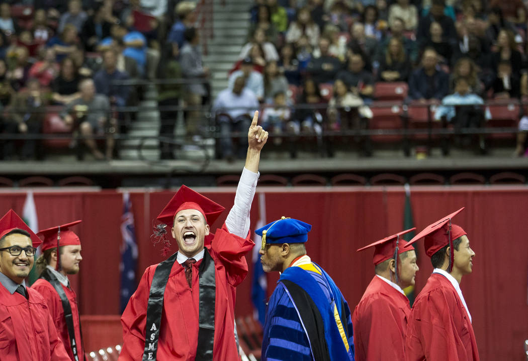 University of Nevada Las Vegas student jumps for joy before UNLV's 54th commencement ceremony at the Thomas & Mack Center on Tuesday, Dec. 19, 2017, in Las Vegas. Richard Brian Las Vegas Revie ...