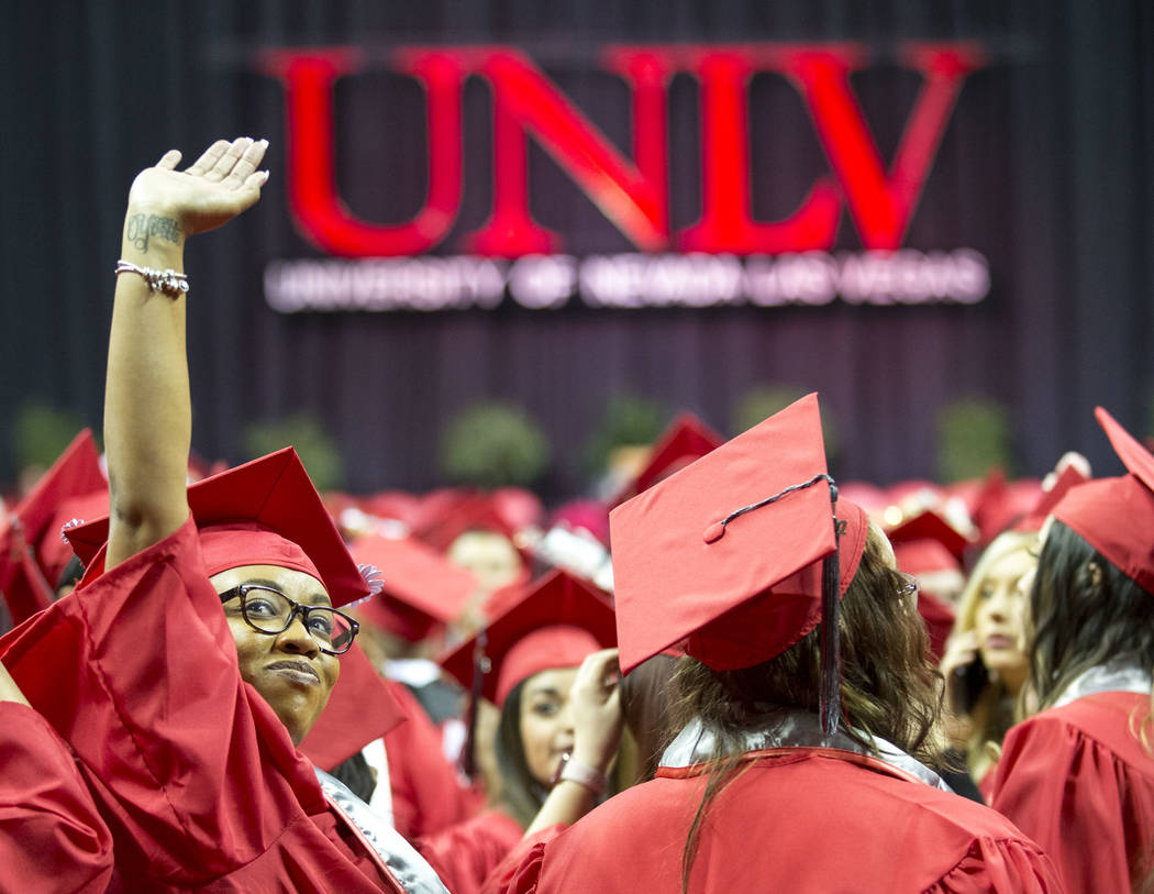 A University of Nevada Las Vegas student waves to the crowd before UNLV's 54th commencement ceremony at the Thomas & Mack Center on Tuesday, Dec. 19, 2017, in Las Vegas. Richard Brian Las Vega ...