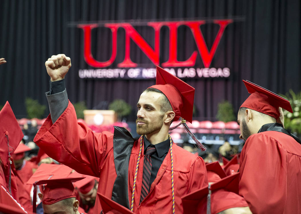 University of Nevada Las Vegas student Trent Beers pumps his first before UNLV's 54th commencement ceremony at the Thomas & Mack Center on Tuesday, Dec. 19, 2017, in Las Vegas. Richard Brian L ...