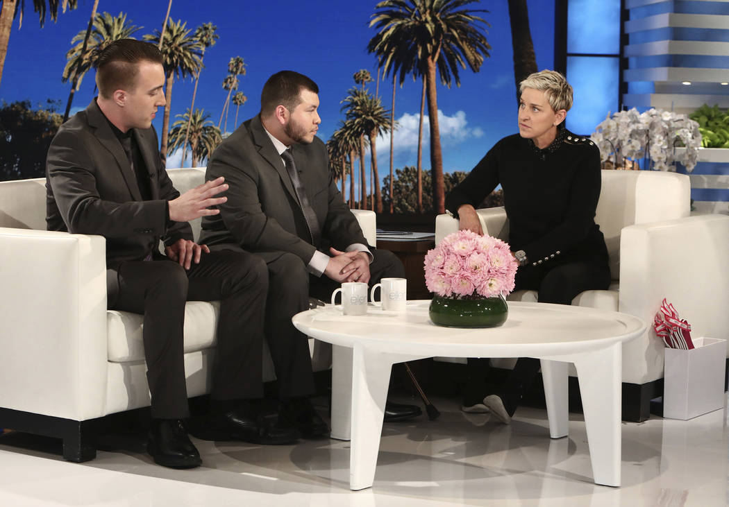 """In this Oct. 17, 2017, photo released by Warner Bros., Stephen Schuck, left, and Jesus Campos appear with host Ellen Degeneres during a taping of """"The Ellen DeGeneres Show"""" at the Warner Bros. lot ..."""