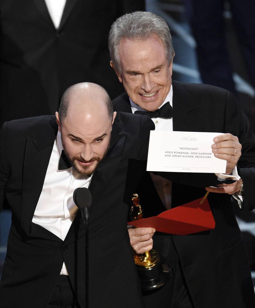 "Jordan Horowitz, producer of ""La La Land,"" shows the envelope revealing ""Moonlight"" as the true winner of best picture as presenter Warren Beatty looks on at th ..."