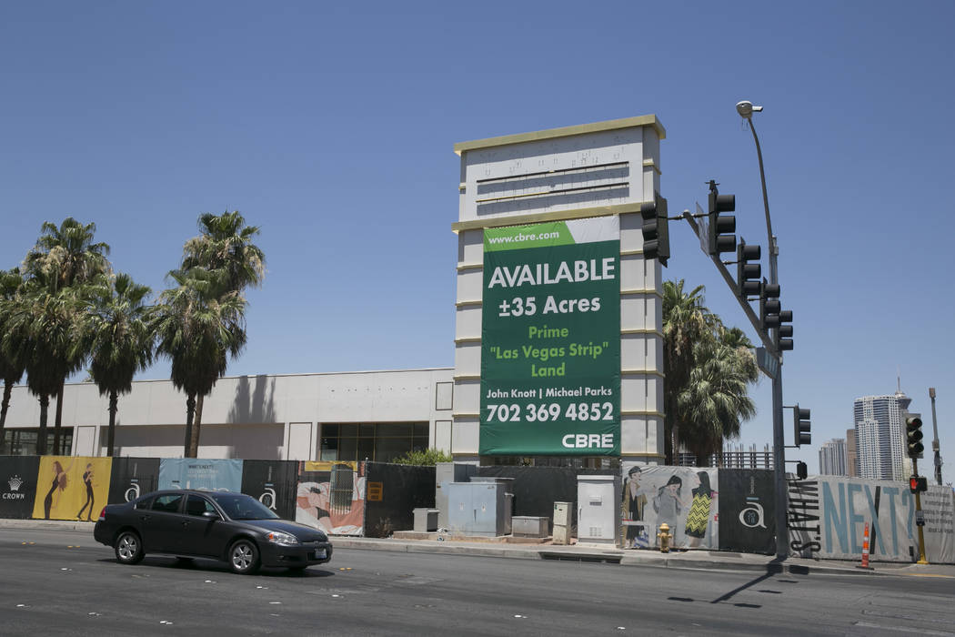 A for sale sign is seen at the site of the never-built Alon casino-resort at the corner of Las Vegas Boulevard and Fashion Show Drive in Las Vegas, Thursday, June 22, 2017. (Gabriella Angotti-Jone ...