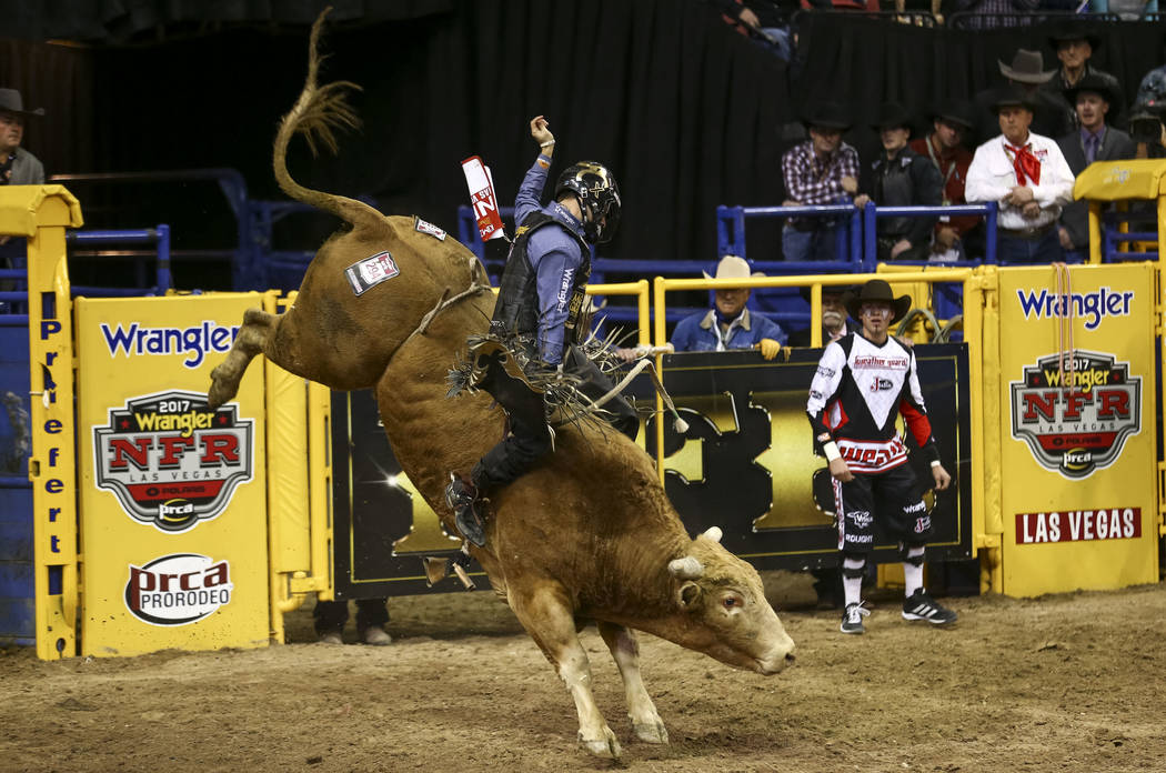 Sage Kimzey of Strong City, Okla., rides Little Chubby to a score of 81.5 points during the seventh go-round of the Wrangler National Finals Rodeo on Wednesday night at the Thomas & Mack Cente ...