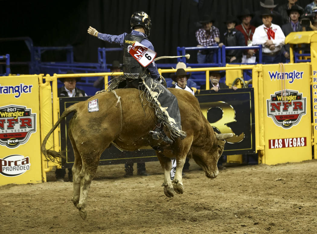Sage Kimzey of Strong City, Oklahoma takes part in the bull riding competition during the seventh go-round of the National Finals Rodeo, Wednesday, Dec. 13, 2017, at the Thomas & Mack Center i ...