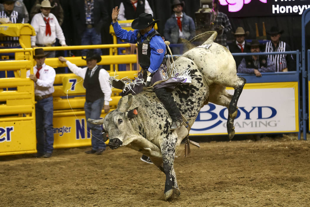 Tim Bingham of Honeyville, Utah takes part in the bull riding competition during the seventh go-round of the National Finals Rodeo, Wednesday, Dec. 13, 2017, at the Thomas & Mack Center in Las ...