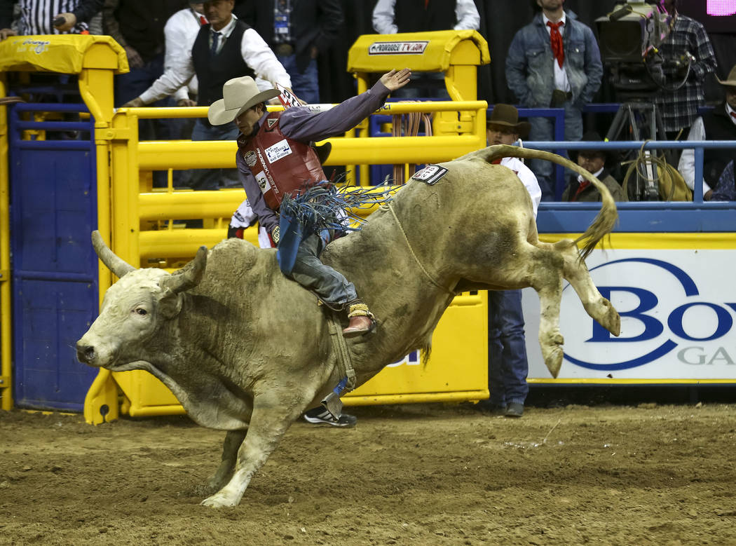 Roscoe Jarboe of New Plymouth, Idaho takes part in the bull riding competition during the seventh go-round of the National Finals Rodeo, Wednesday, Dec. 13, 2017, at the Thomas & Mack Center i ...