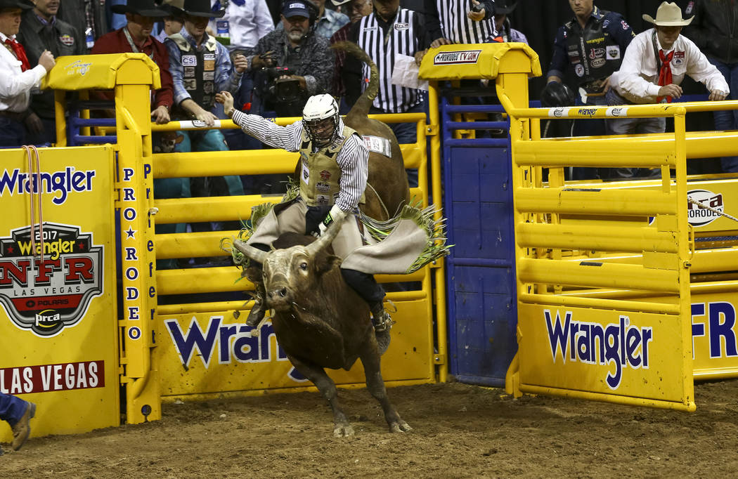 Jordan Spears of Redding, California takes part in the bull riding competition during the seventh go-round of the National Finals Rodeo, Wednesday, Dec. 13, 2017, at the Thomas & Mack Center i ...
