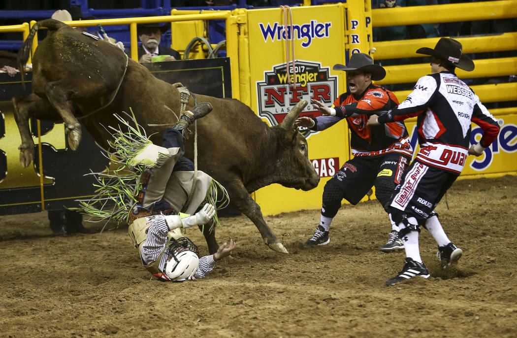 Jordan Spears of Redding, California gets bucked off Little Chubby in the bull riding competition during the seventh go-round of the National Finals Rodeo, Wednesday, Dec. 13, 2017, at the Thomas  ...