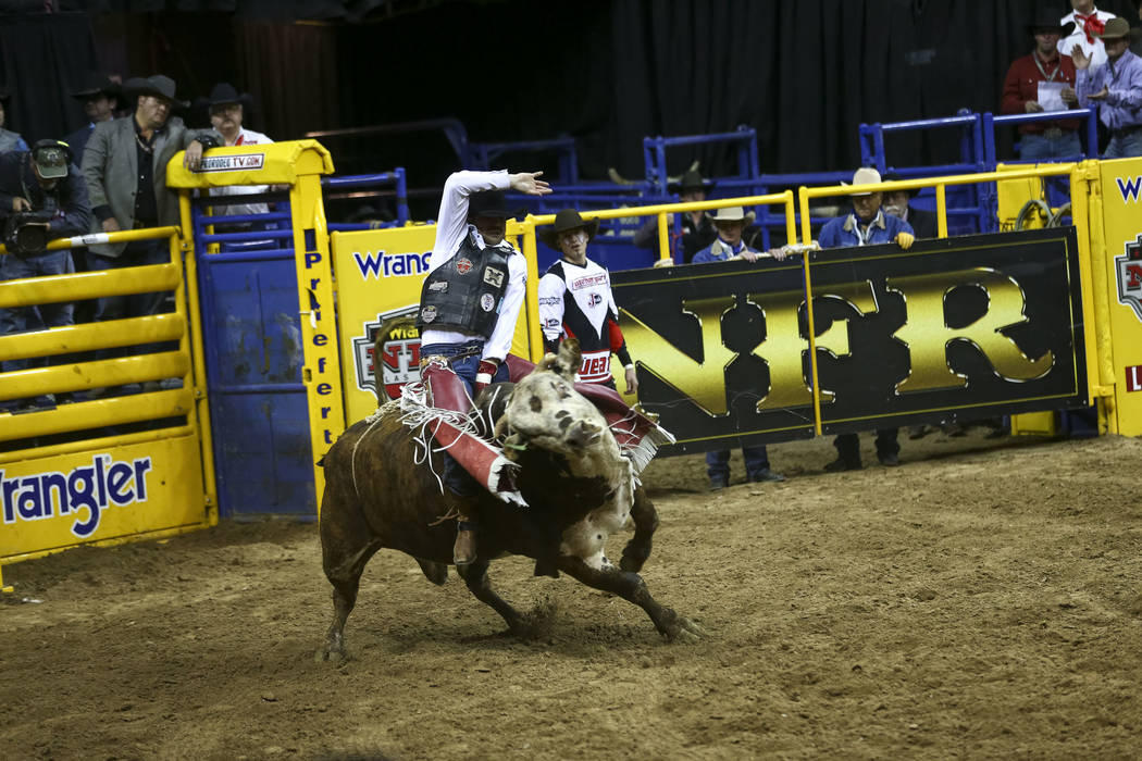 Guthrie Murray of Miami, Oklahoma takes part in the bull riding competition during the seventh go-round of the National Finals Rodeo, Wednesday, Dec. 13, 2017, at the Thomas & Mack Center in L ...