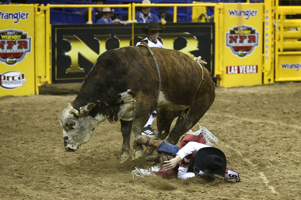 Guthrie Murray of Miami, Oklahoma is bucked off Muley Maddness in the bull riding competition during the seventh go-round of the National Finals Rodeo, Wednesday, Dec. 13, 2017, at the Thomas &amp ...