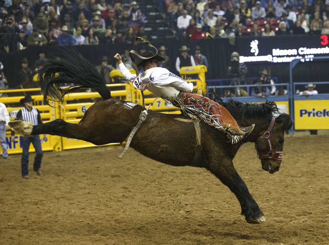 Mason Clements of Santaquin, Utah takes part in the bareback riding competition during the seventh go-round of the National Finals Rodeo, Wednesday, Dec. 13, 2017, at the Thomas & Mack Center  ...
