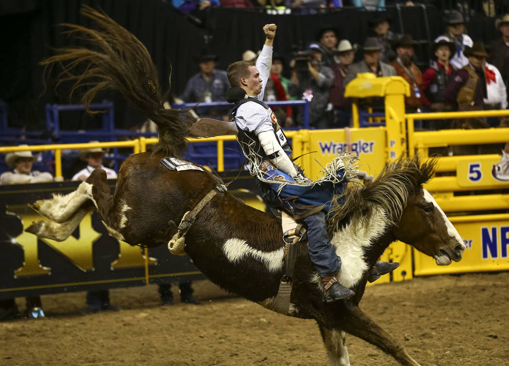 Orin Larson of Inglis, Manitoba takes part in the bareback riding competition during the seventh go-round of the National Finals Rodeo, Wednesday, Dec. 13, 2017, at the Thomas & Mack Center in ...