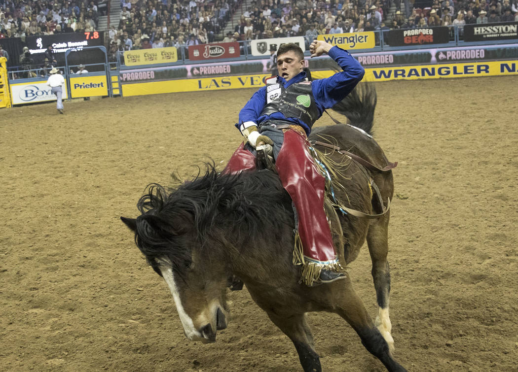 Caleb Bennett of Tremonton, Utah takes part in the bareback riding competition during the seventh go-round of the National Finals Rodeo, Wednesday, Dec. 13, 2017, at the Thomas & Mack Center i ...