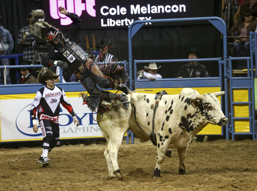 Cole Melancon of Liberty, Texas is bucked off Piano Bar Bandit in the bull riding competition during the seventh go-round of the National Finals Rodeo, Wednesday, Dec. 13, 2017, at the Thomas &amp ...