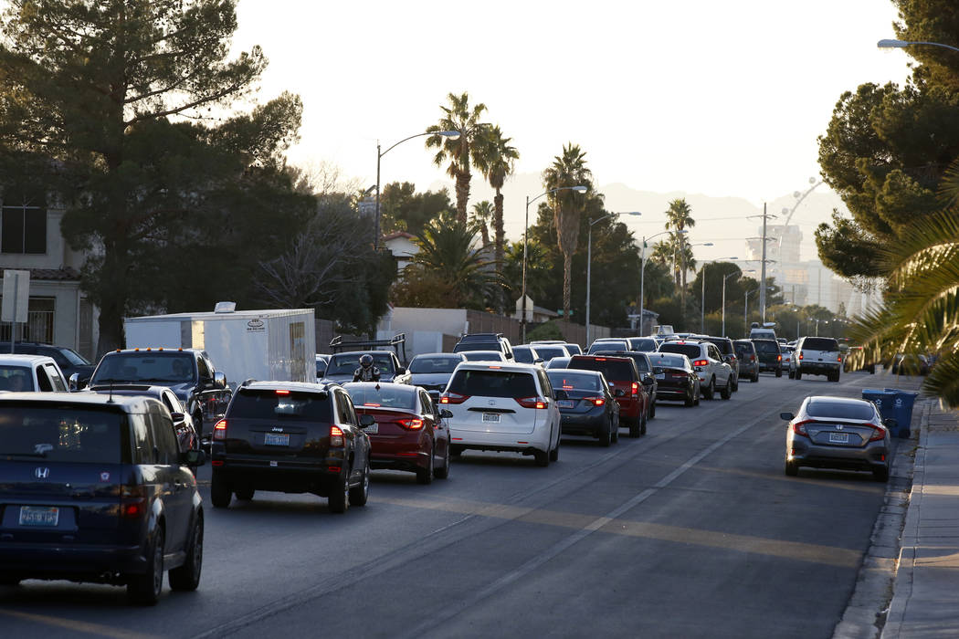 Traffic backs up on Viking road near the intersection of Eastern Avenue and Flamingo Road where a multiple-vehicle crash left three children dead Wednesday, Dec. 13, 2017. Police said six people w ...
