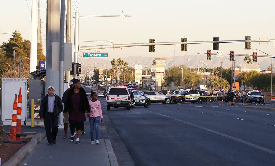 Las Vegas police in the intersection of Eastern Avenue and Flamingo Road where a multiple-vehicle crash left three children dead Wednesday, Dec. 13, 2017. Police said six people were transported t ...