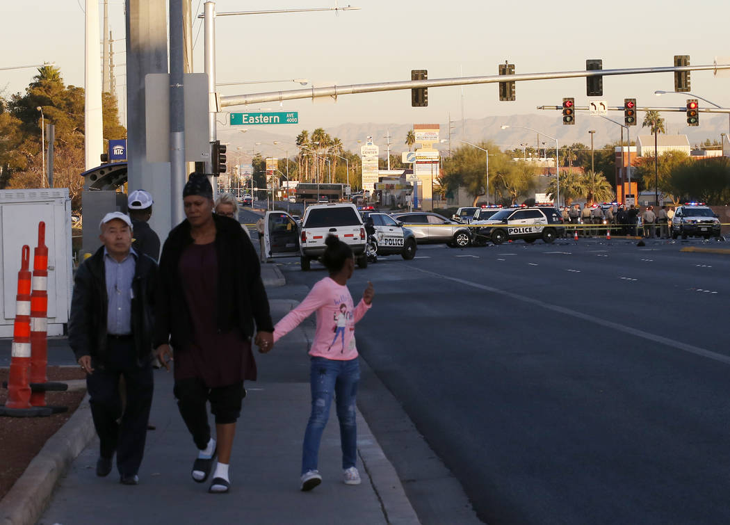 Las Vegas police in the intersection of Eastern Avenue and Flamingo Road where a multiple-vehicle crash left three children dead Wednesday, Dec. 13, 2017. Police said seven people were transported ...