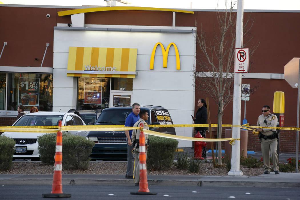 Las Vegas police sting crime scene tape near Eastern Avenue and Flamingo Road where a multiple-vehicle crash left three people dead Wednesday, Dec. 13, 2017. Police said six people were transporte ...