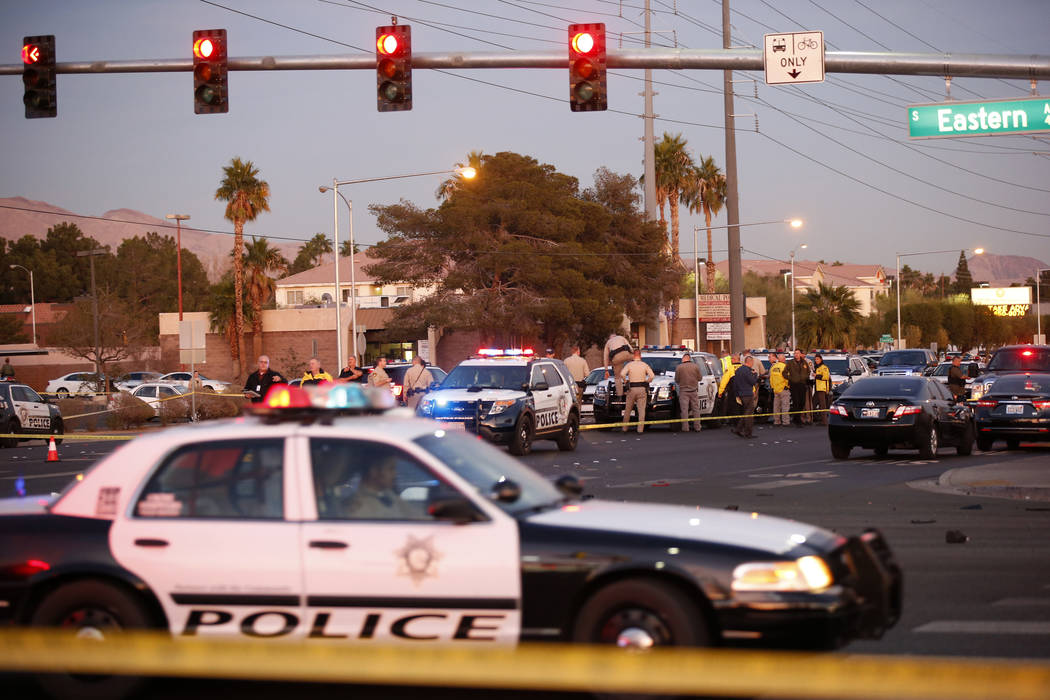 Las Vegas police in the intersection of Eastern Avenue and Flamingo Road where a multiple-vehicle crash left three people dead Wednesday, Dec. 13, 2017. Police said six people were transported to  ...