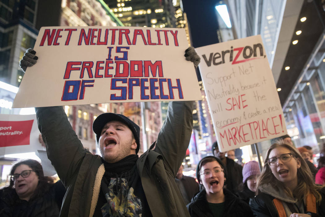 """Demonstrators rally in support of net neutrality outside a Verizon store in New York, Thursday, Dec. 7, 2017. The Federal Communications Commission voted Thursday, Dec. 14 to undo Obama-era """"net ..."""