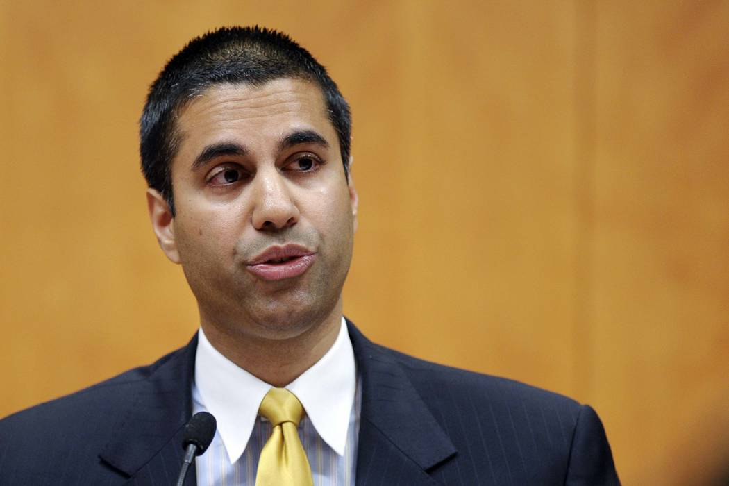 Federal Communications Commission Commissioner Ajit Pai speaks during an FCC meeting in Washington in 2013. (Susan Walsh/AP, File)