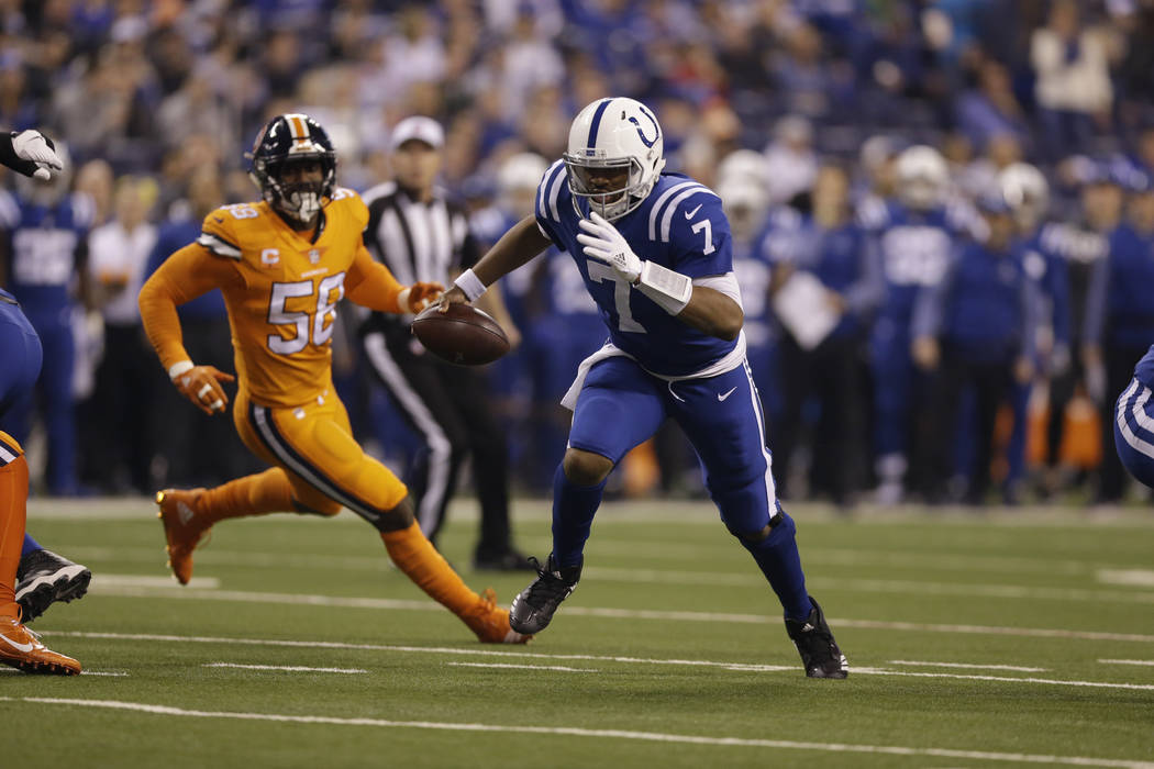 Indianapolis Colts quarterback Jacoby Brissett (7) runs for a touchdown against the Denver Broncos during the first half of an NFL football game in Indianapolis, Thursday, Dec. 14, 2017. (AP Photo ...