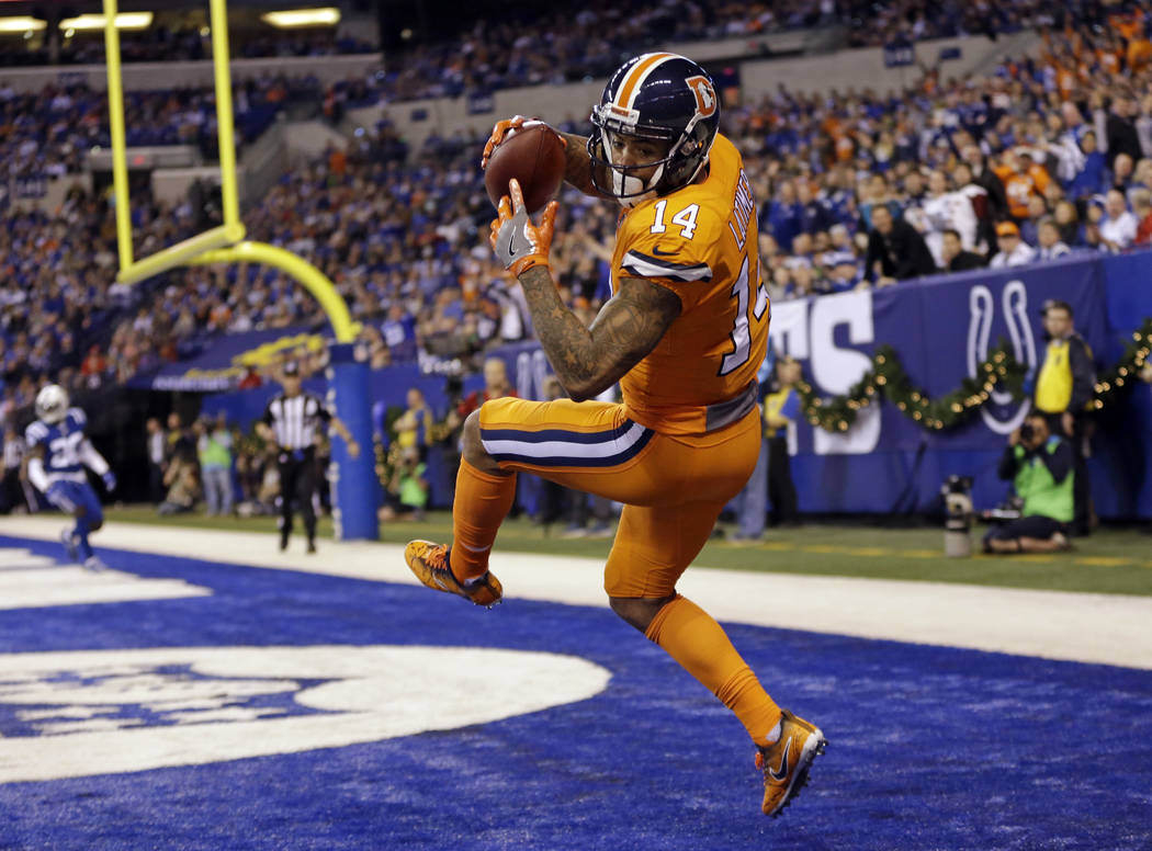 Denver Broncos wide receiver Cody Latimer (14) makes a catch for a two-point conversion during the second half of an NFL football game against the Indianapolis Colts in Indianapolis, Thursday, Dec ...
