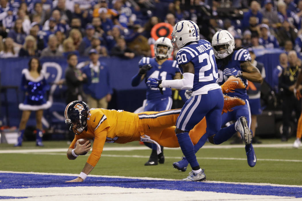 Denver Broncos quarterback Brock Osweiler (17) dives into the end zone for a rushing touchdown against the Indianapolis Colts during the first half of an NFL football game in Indianapolis, Thursda ...