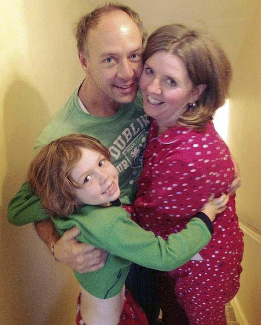 This undated family photo provided by Sandy Hook Promise shows Mark Barden, center, with his son Daniel, left, and wife Jacqueline. Daniel was among those killed in the Sandy Hook Elementary Schoo ...
