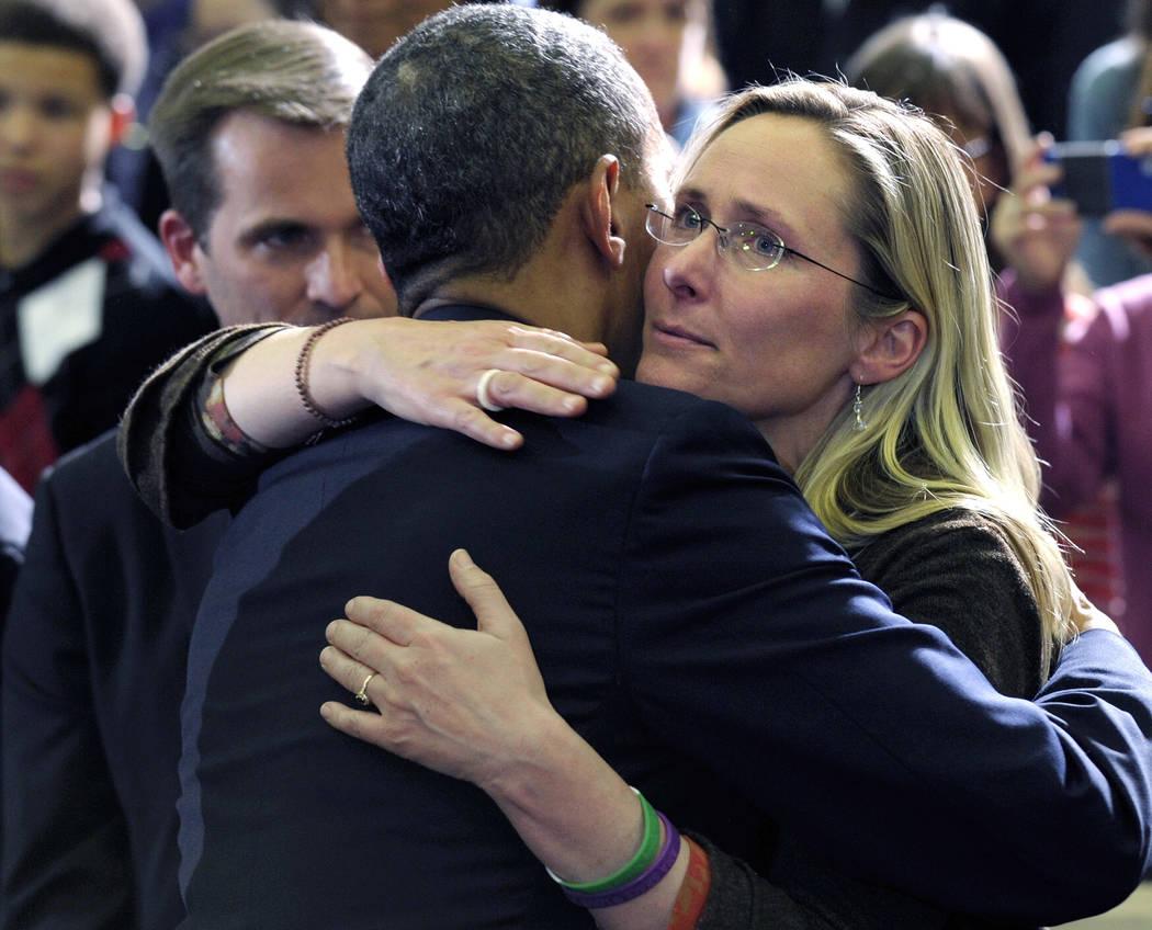President Barack Obama embraces Scarlett Lewis, mother of Sandy Hook Elementary School shooting victim Jesse Lewis, after speaking at in Hartford, Conn., April 8, 2013. Her Jesse Lewis Choose Love ...