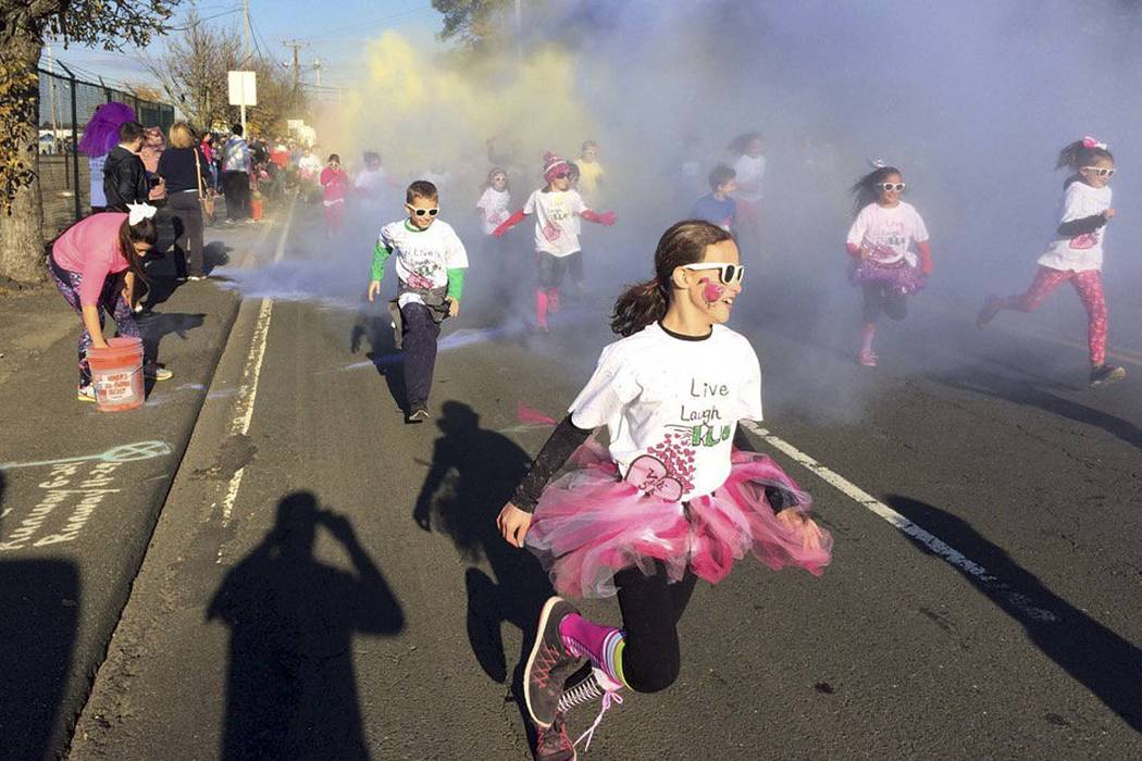 Children participate in the fun run at the annual Vicki Soto 5K race in Stratford, Conn., Nov. 5, 2016. The race is held by the Soto family to raise money to fund scholarships for students interes ...