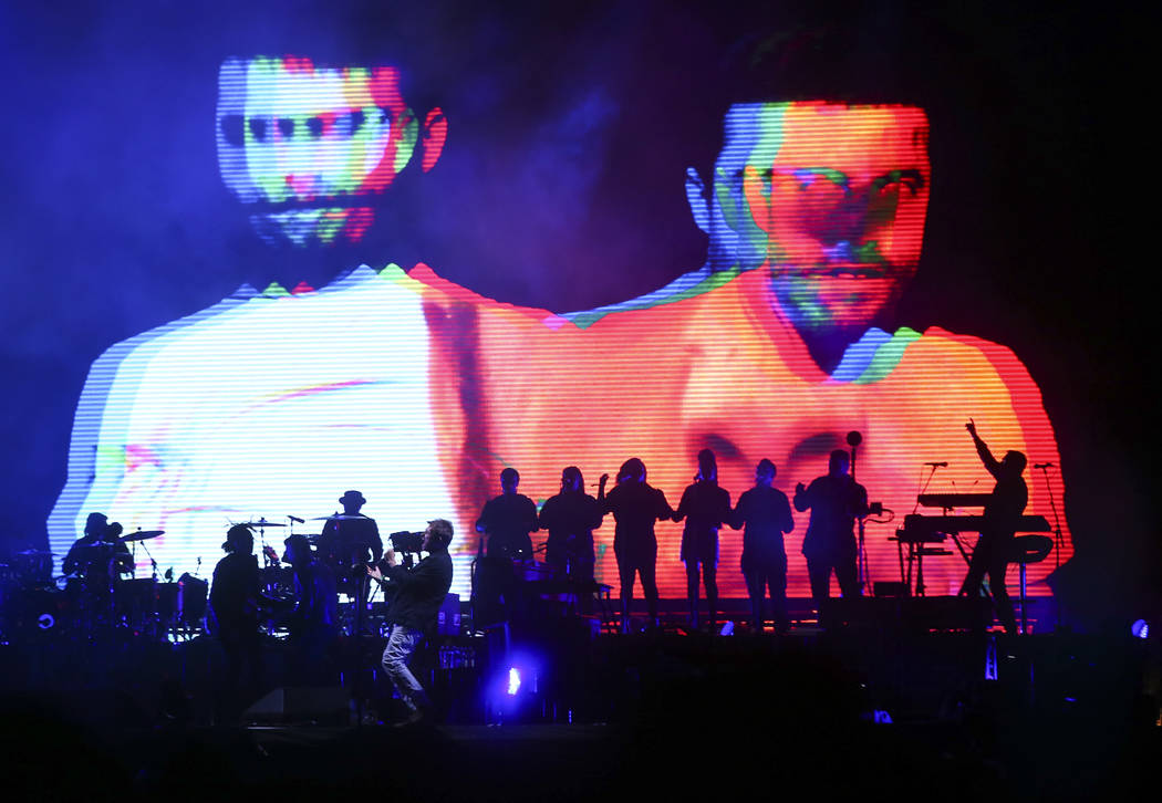 Damon Albarn of Gorillaz, lower left, performs at the Downtown stage during the final day of the Life is Beautiful festival in downtown Las Vegas on Sunday, Sept. 24, 2017. Chase Stevens Las Vegas ...